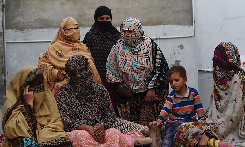 Mothers whose children were sexually abused by a gang gather at a house in the village of Hussain Khanwala on August 10, 2015. – AFP