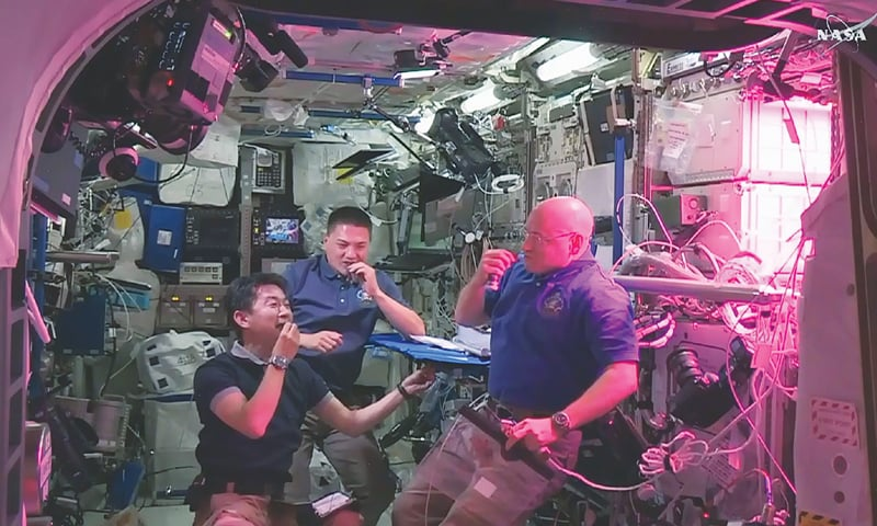 AN image grabbed off NASA TV on Monday shows (left to right) Japanese astronaut Kimiya Yui and US astronauts Kjell Lindgren and Scott Kelly  eating red romaine lettuce grown on board the International Space Station .—AFP
