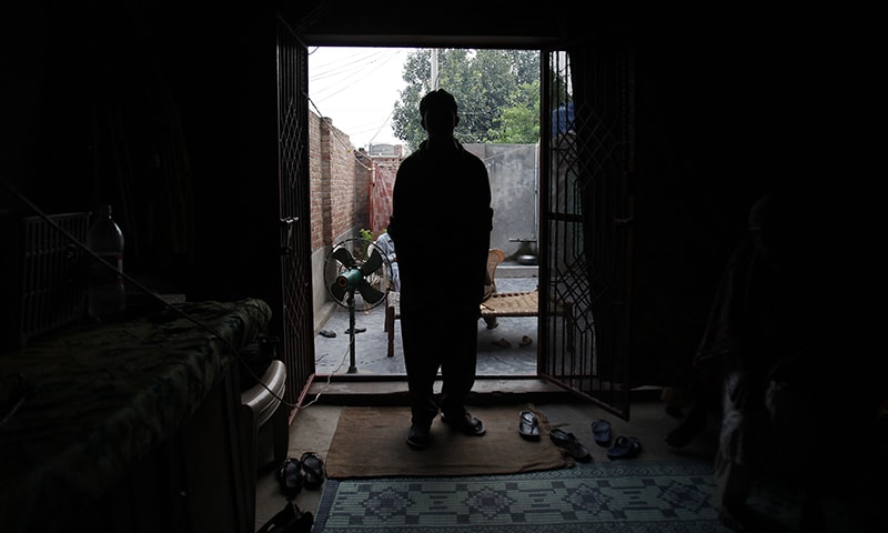 A victim of a child sex abuse scandal stands in his house in Hussain Khan Wala town, Kasur. ─ AP/File