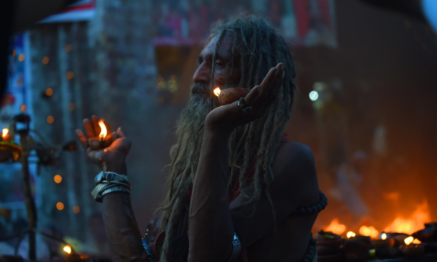 A devotee at Lahore's Mela Chiraghan | M Arif, White Star