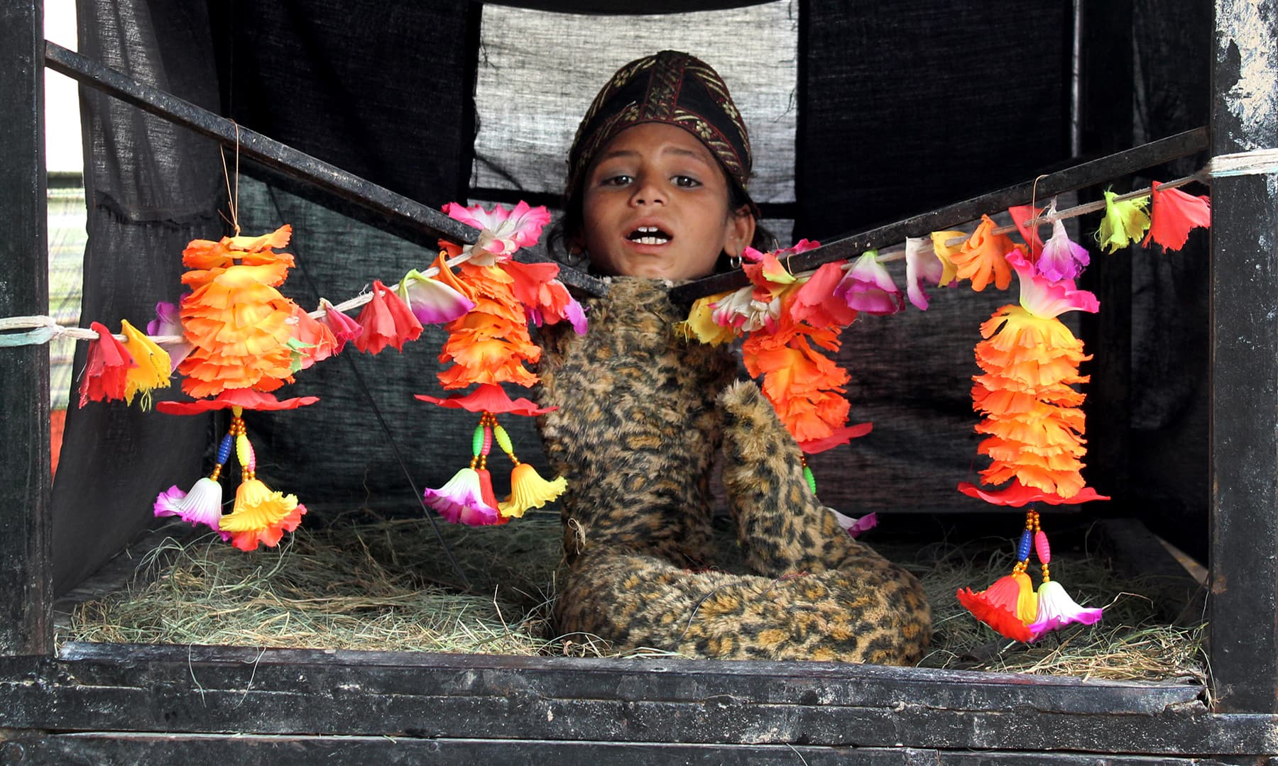 A girl with a snake's body at the Uch mela | Danyal Adam  Khan