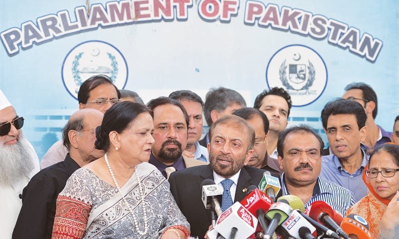 ISLAMABAD: MQM leader Farooq Sattar speaks to reporters along with his party's MNAs and senators who submitted their resignations here on Wednesday.—AFP