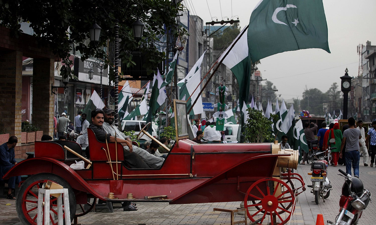 People celebrate the country's upcoming 69th Independence Day in Rawalpindi, Pakistan. — AP