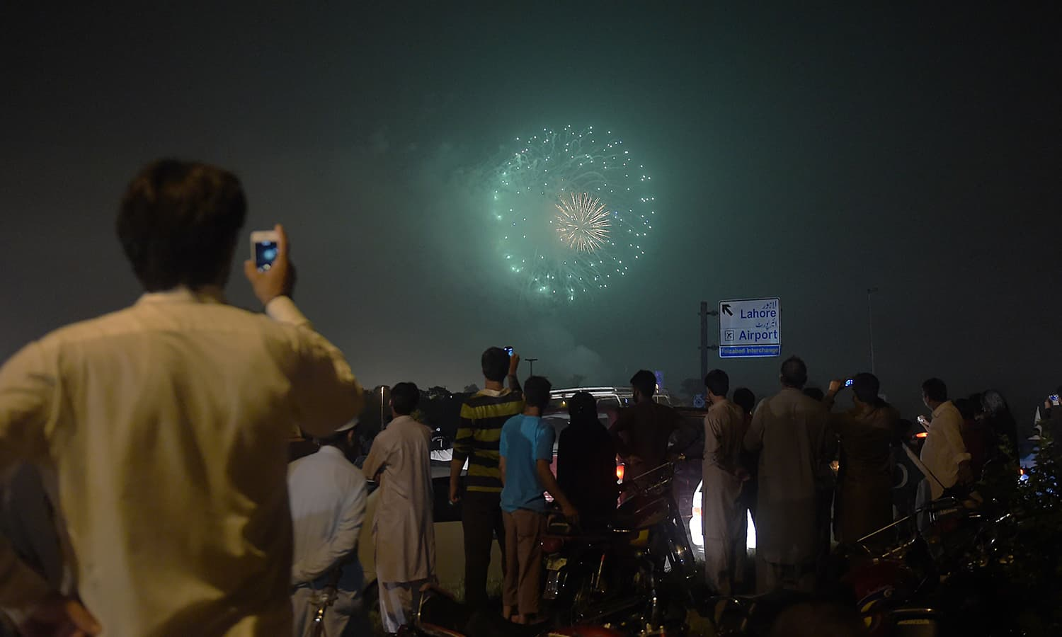 People watch a fireworks display marking Independence Day in Islamabad on August 13, 2015.  — AFP