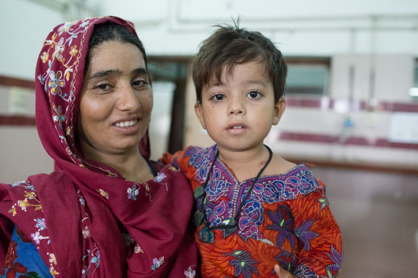 One of the patient's mother smiles for a picture.