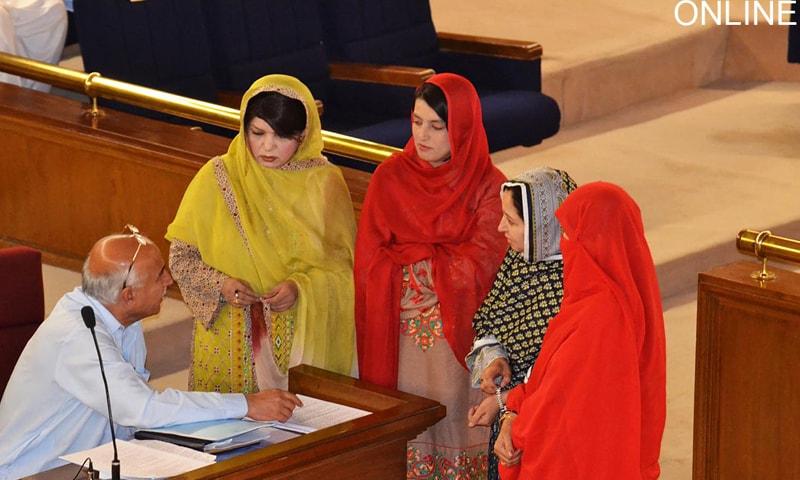 QUETTA: Chief Minister Dr Abdul Malik Baloch talks to women legislators during a Balochistan Assembly session on Saturday.—Online