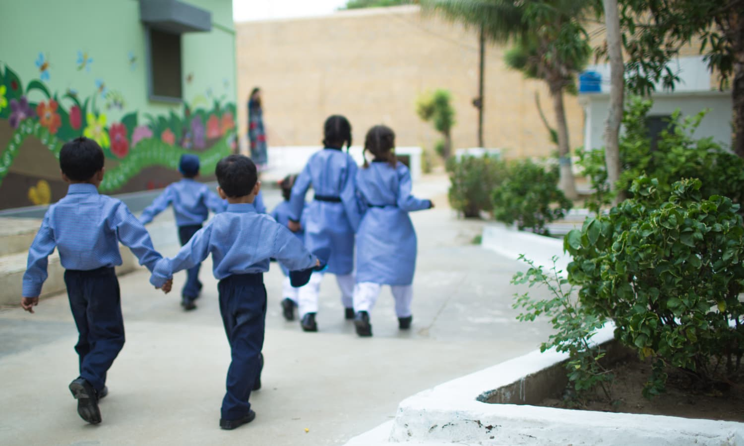 Children making their way to see their new school. Nine children are currently enrolled in the ELC.