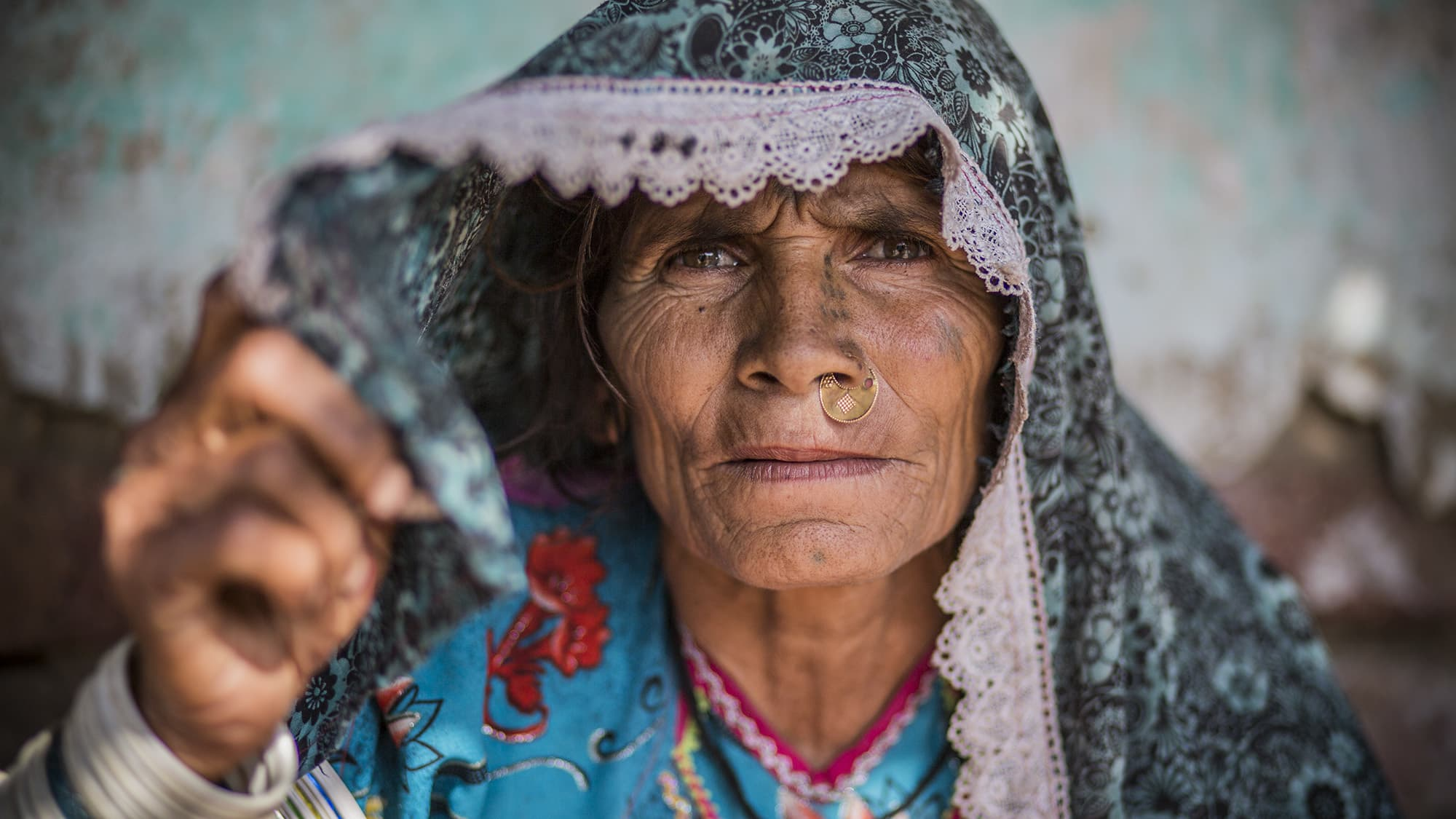 Mai - An old resident of Varshi Kohli village is 70 years old. Her entire village migrated from Nagarparkar to a village in Badin called Varshi Kohli. But here, they face a whole new wrath of climate change. - Photo by Shameen Khan