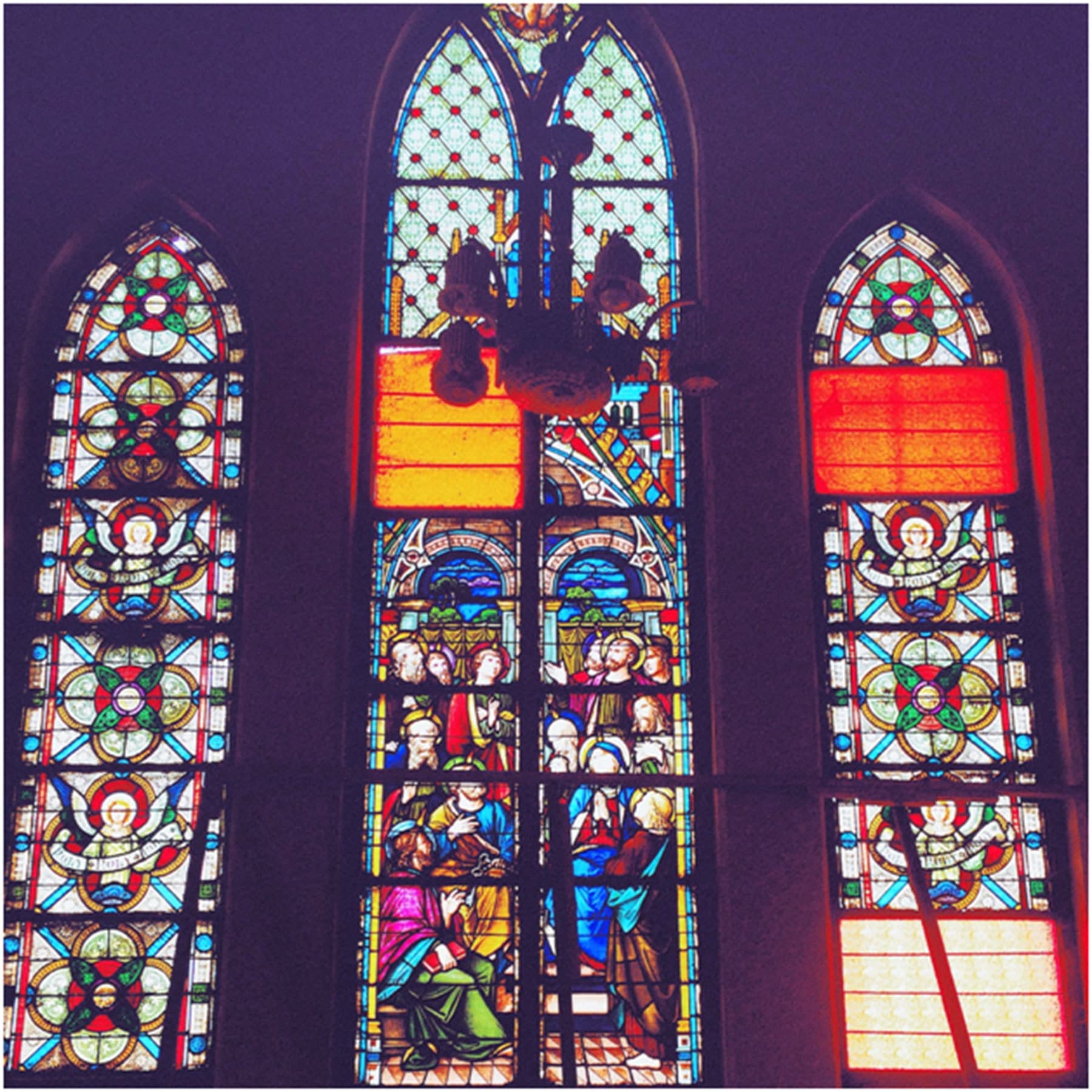One of the beautiful hand stained glass windows of the Church.