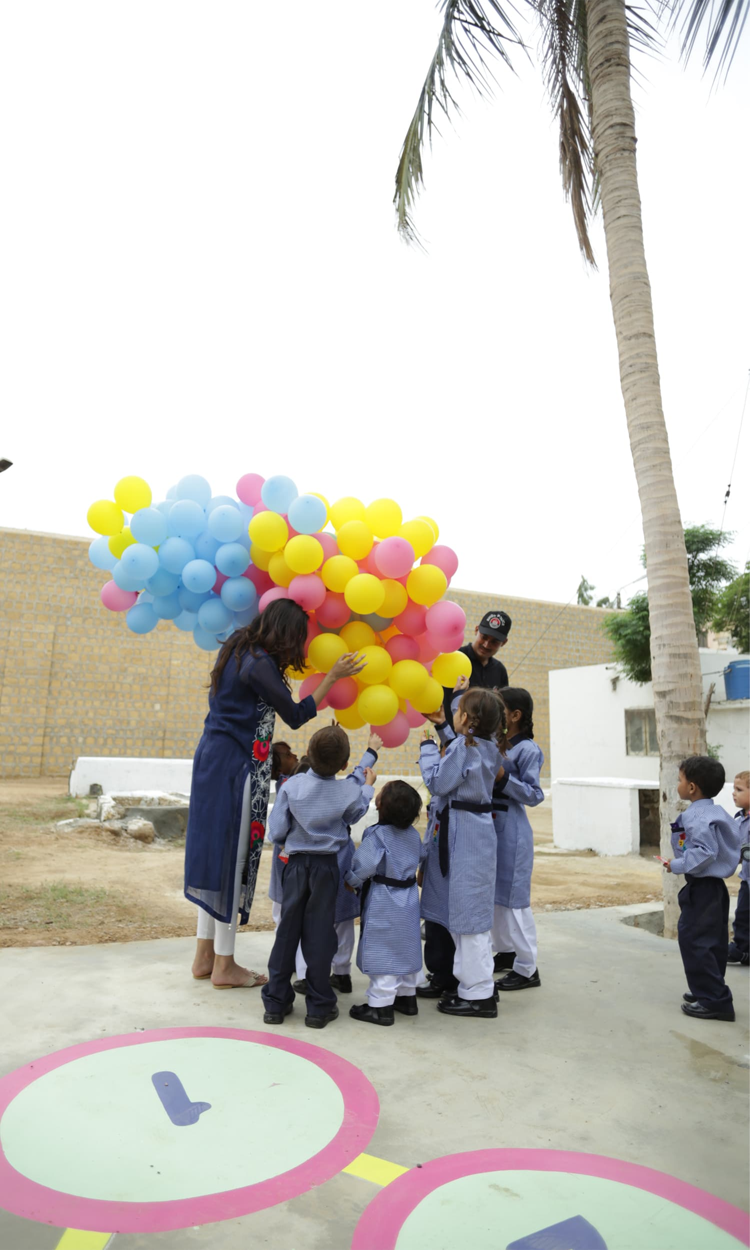 Children surround the balloons during the inauguration ceremony.