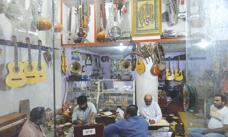 ON the walls of Bhaati Gate's Millat Music Shop hang a variety of instruments, including a couple of sarangis and an oud, an Egyptian guitar, in the Walled City of Lahore.—Arif Ali / White Star
