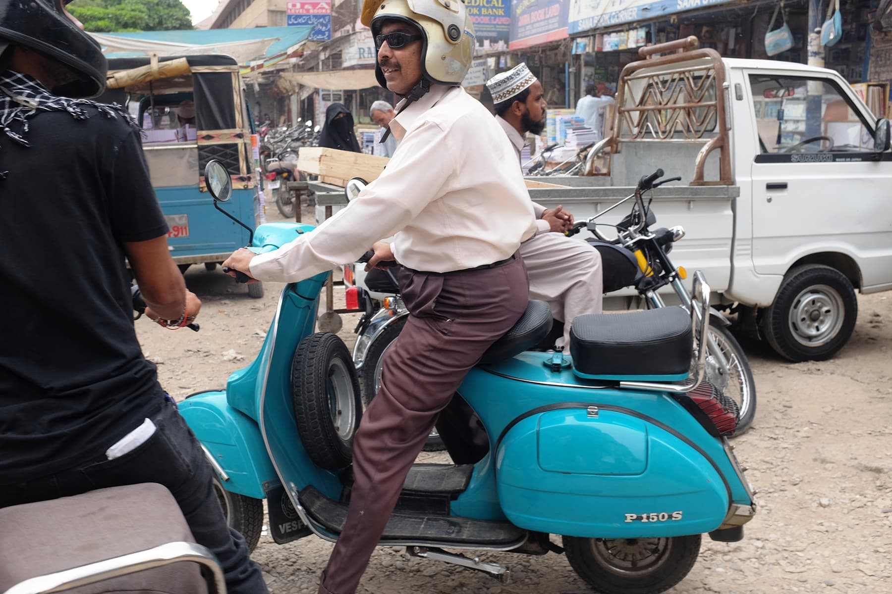 We spot a lot of people going about their business in Vespas.