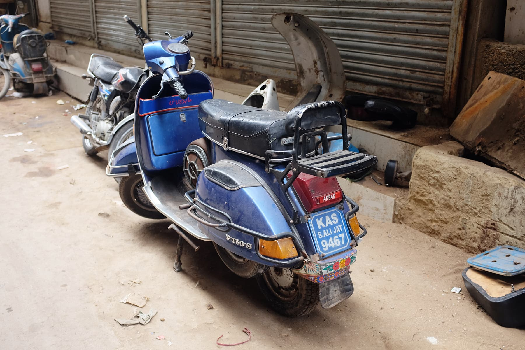 Shehzad shows us different Vespas near his workshop.