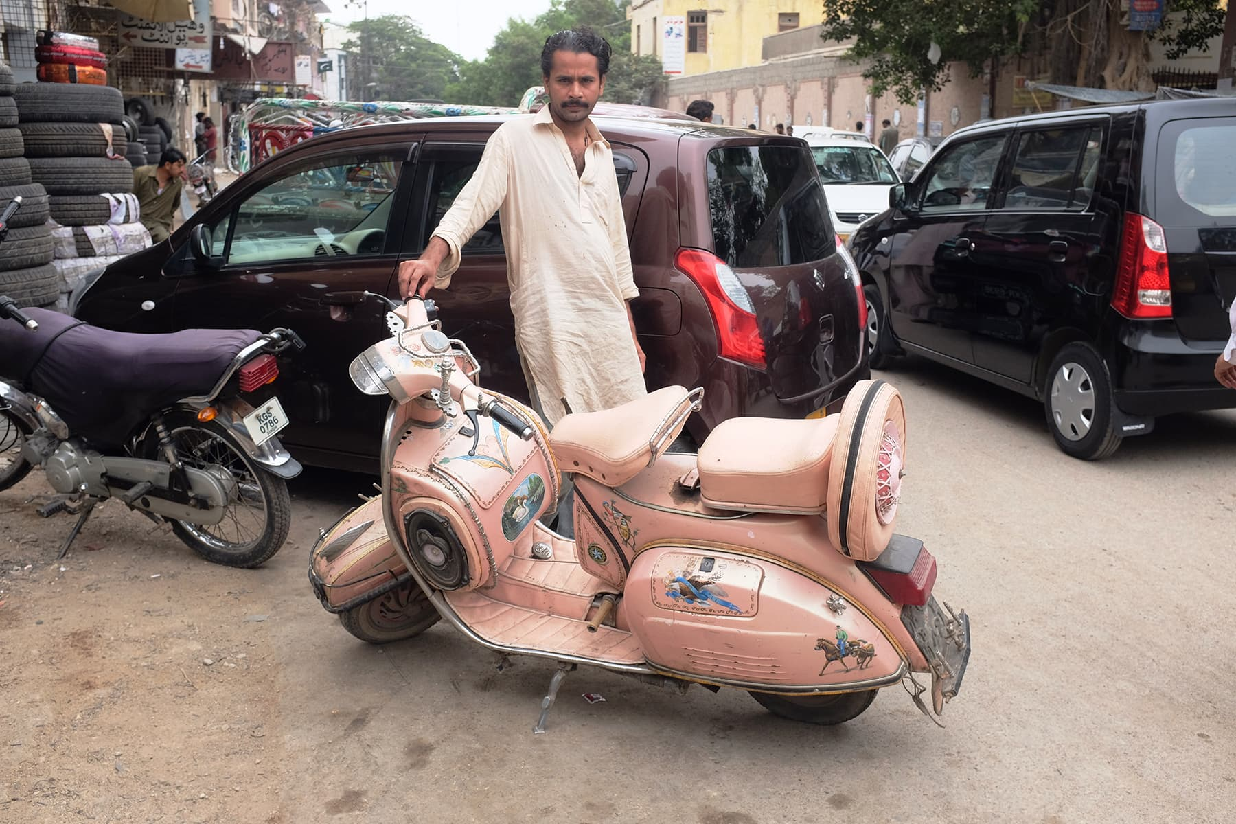 Shehzad poses with his pink '83 model Vespa.