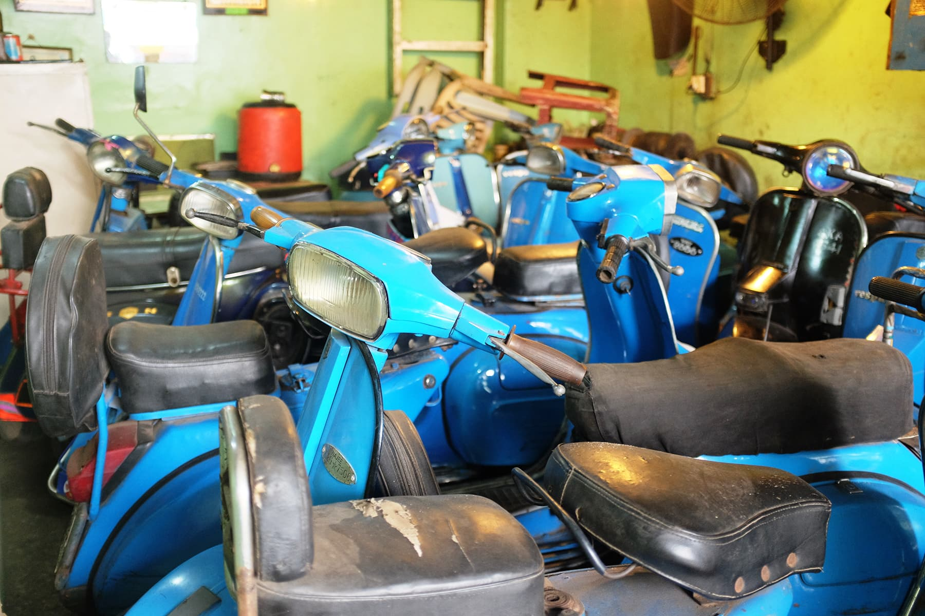 Various models of Vespas inside Abdullah's showroom.