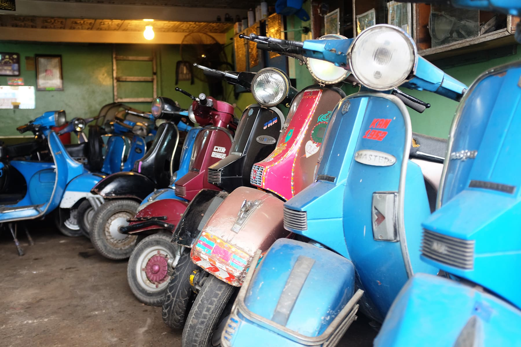 Abdullah has one of the largest collection of Vespas in the city.