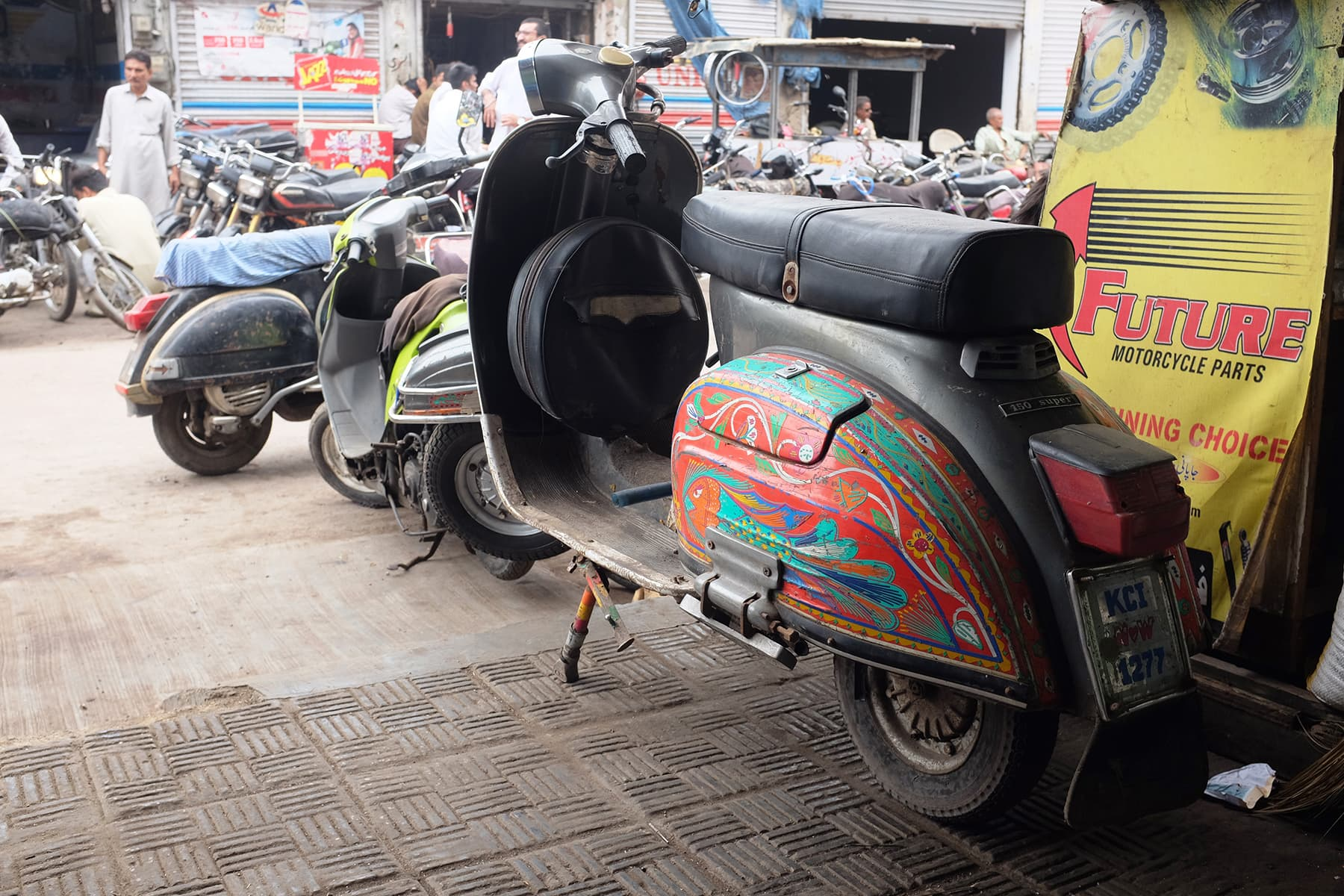 A Vespa with truck art at Abdullah's shworoom.