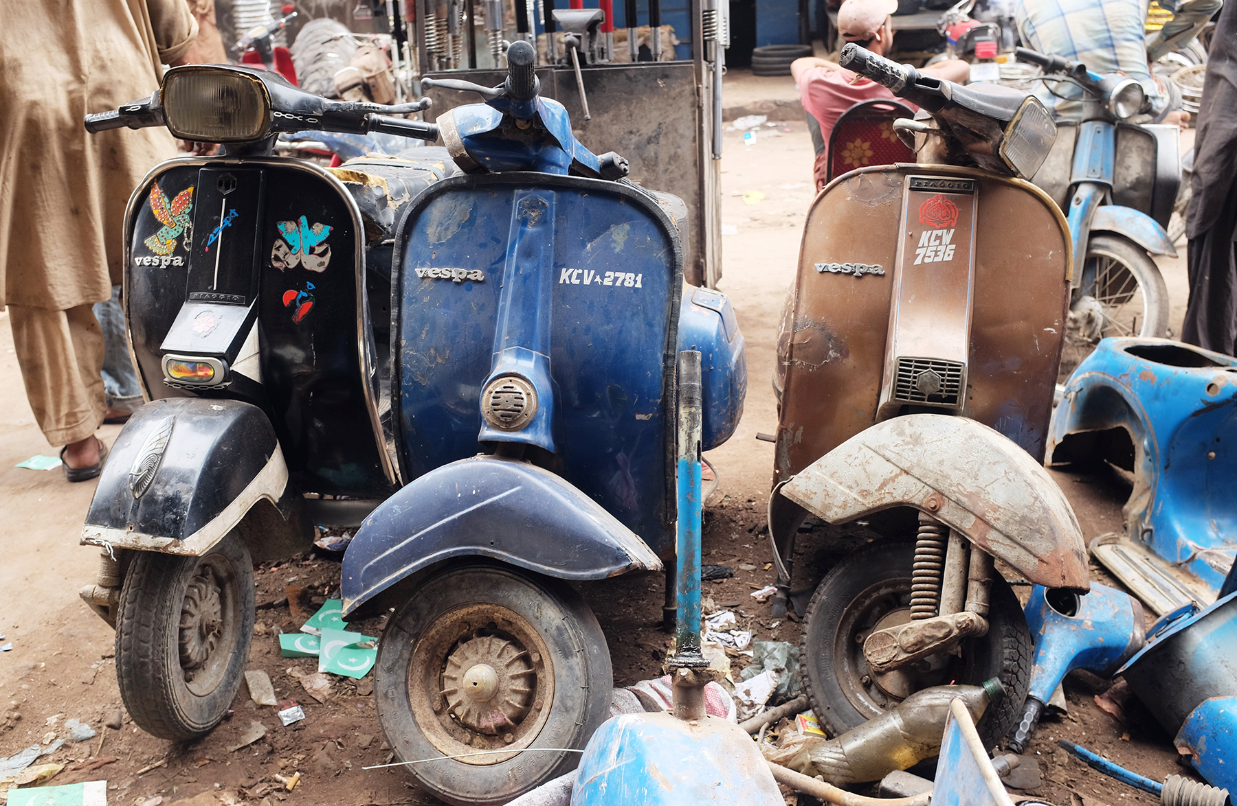 An assortment of colorful Vespas.
