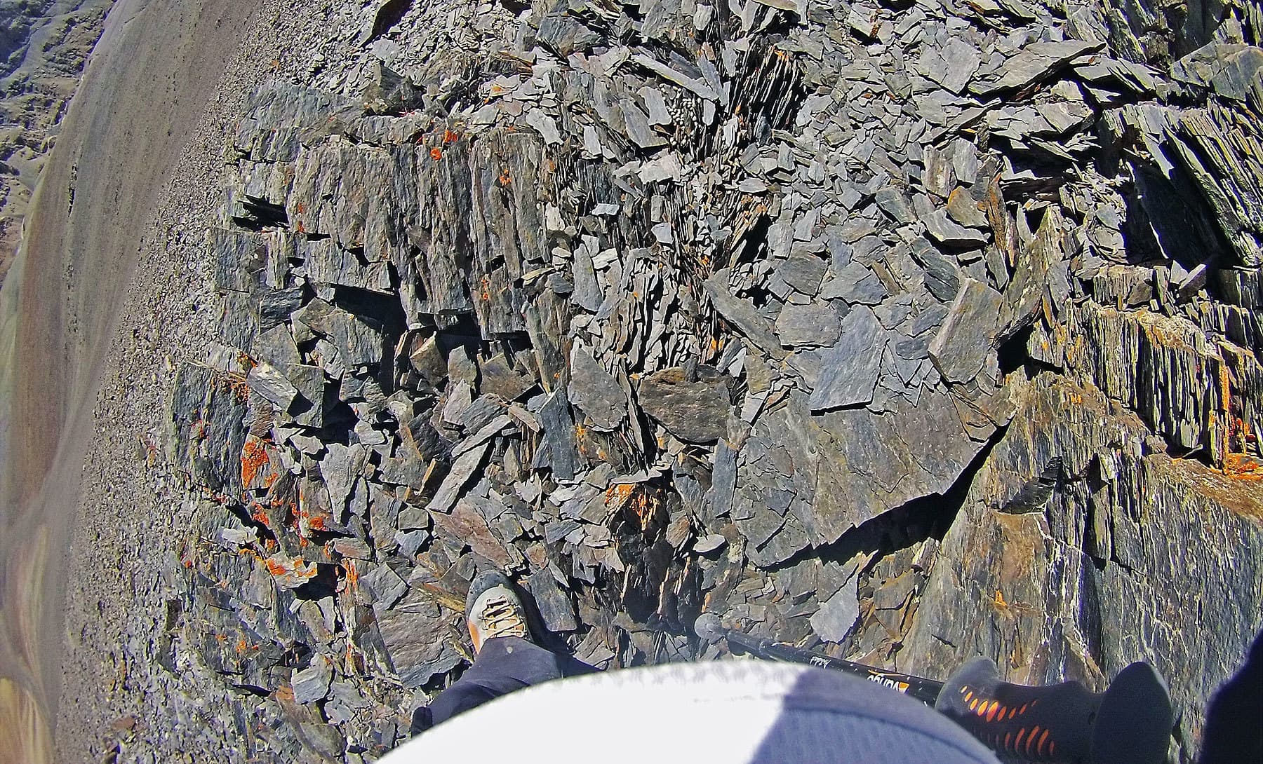 Shards and paper thin wafers of rock close to 5,000m and above.