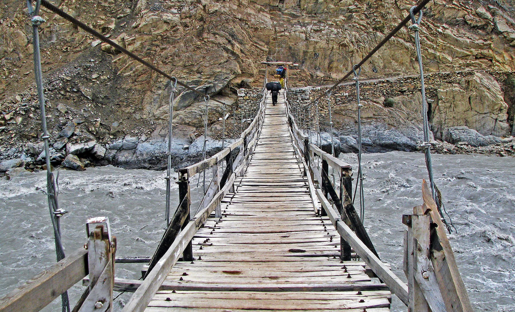 The wooden suspension bridge that connects Shimshal to all places beyond the mighty Shimshal River.
