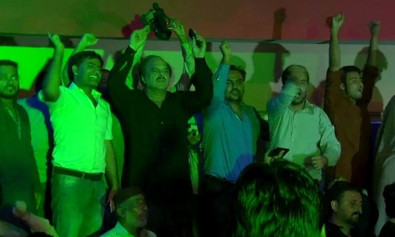 PTI workers and leaders celebrating the tribunal decision in Lahore. – DawnNews screengrab