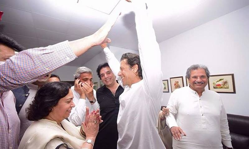 Imran Khan gestures alongside party members after a tribunal deseated Ayaz Sadiq as MNA. – courtesy PTI Facebook page
