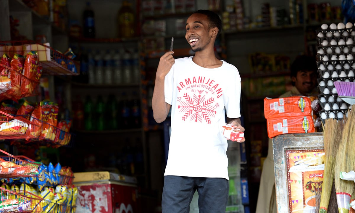 A young Somali man at a store in Islamabad | Taveer Shahzad, White Star