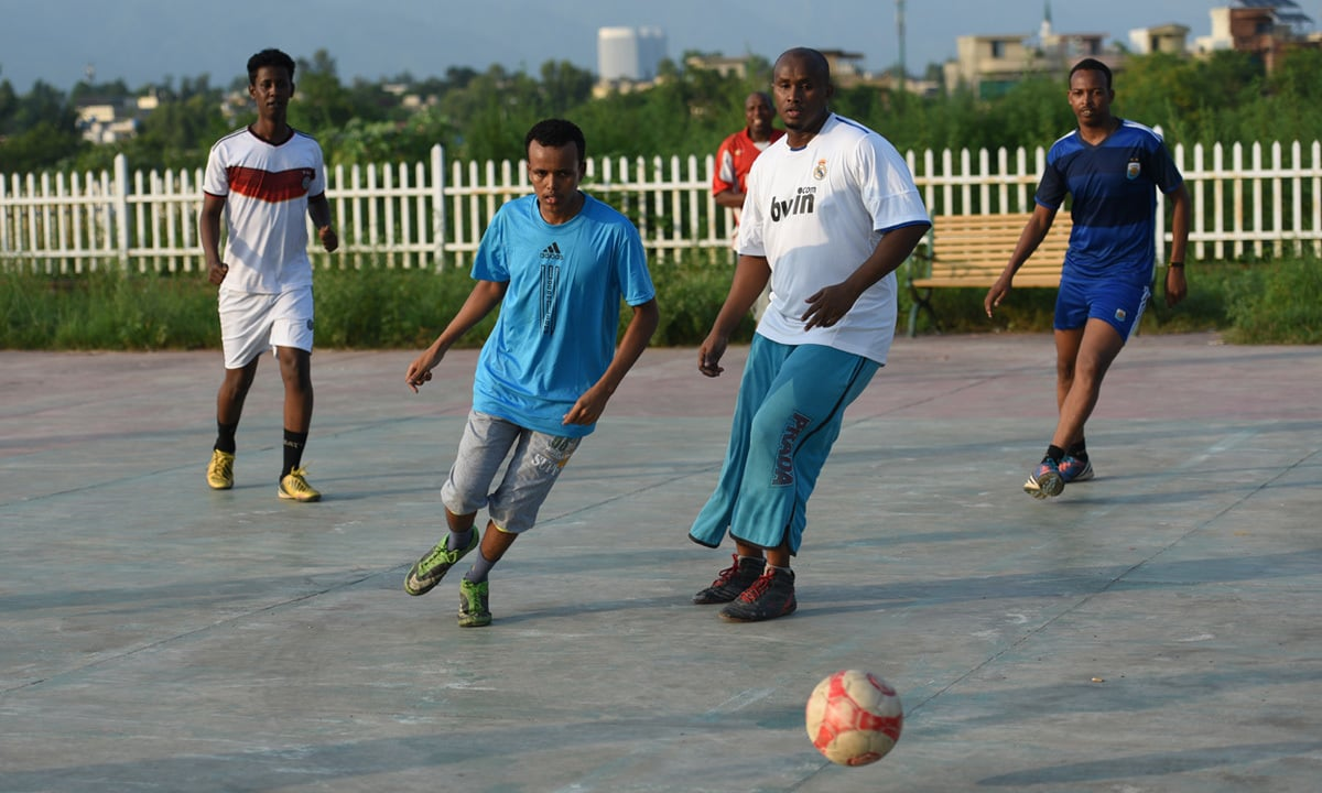 Somali refugees playing football in a community ground | Tanveer Shahzad, White Star
