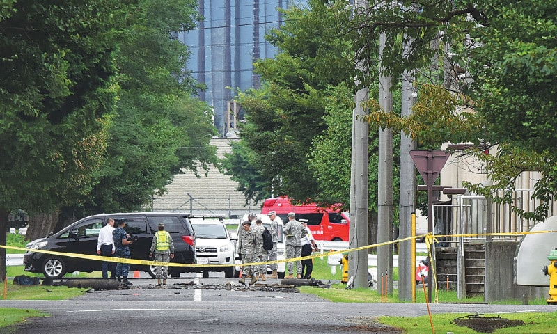 Sagamihara (Japan): US military personnel at the scene of the blast.—AFP