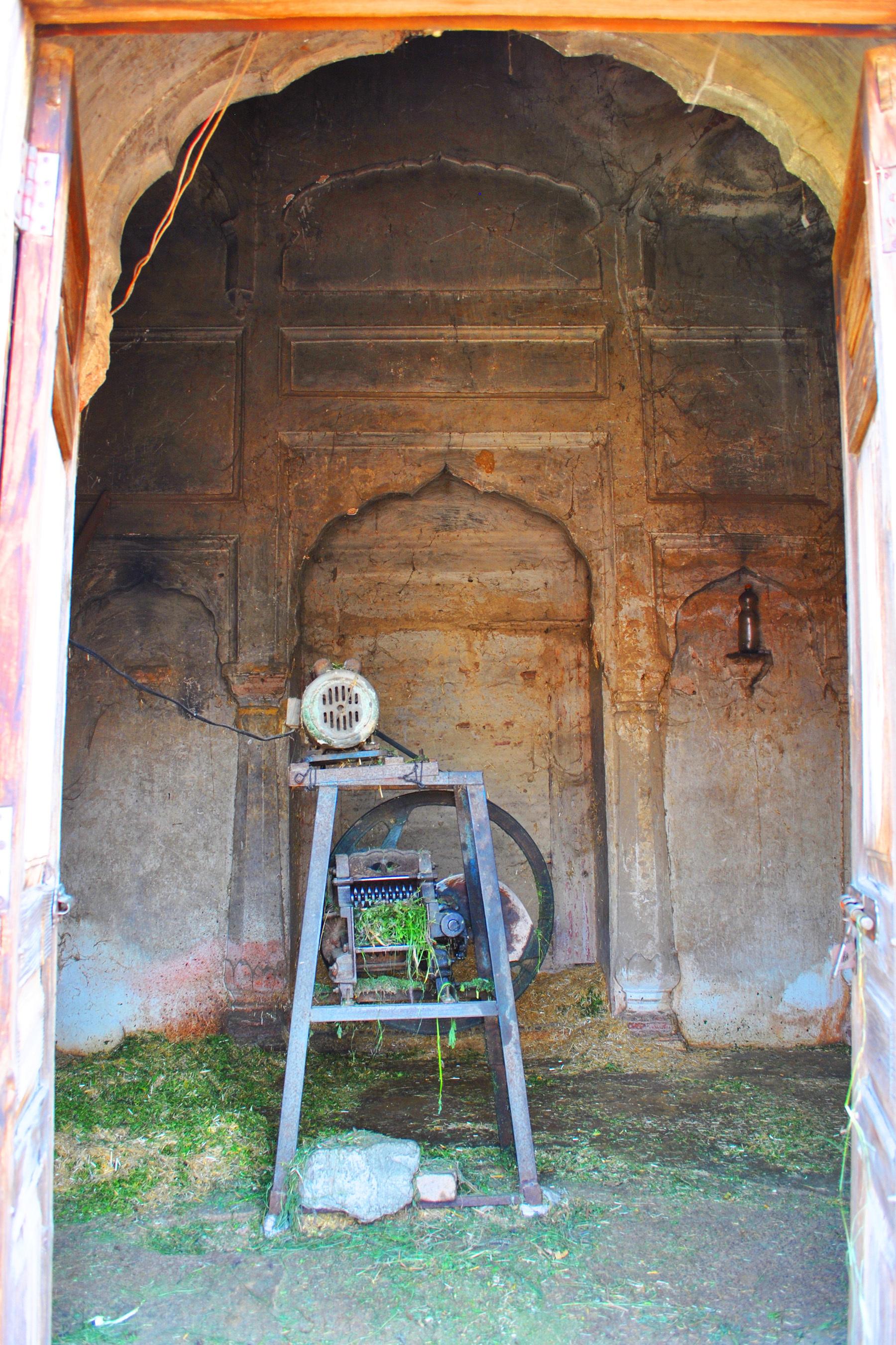 Fodder-cutting machine installed inside a temple.