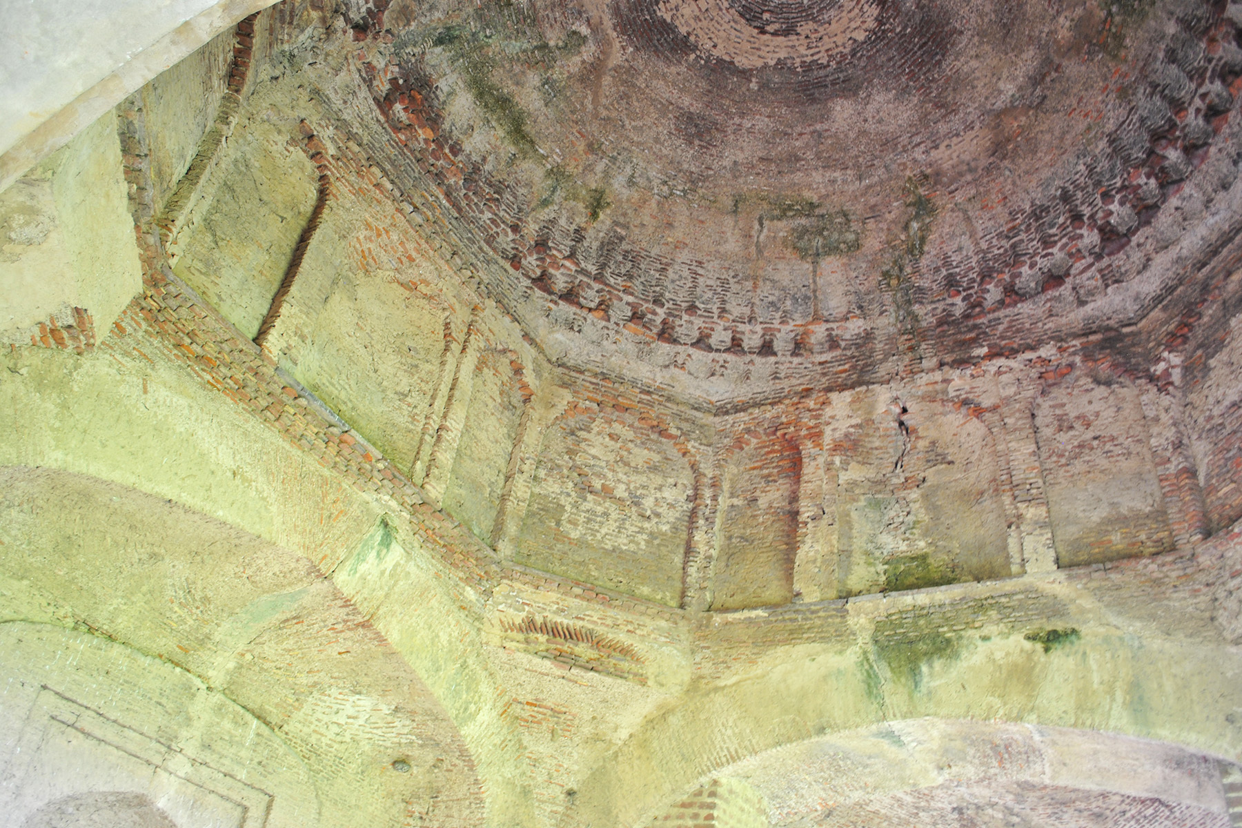 The fine cut-brick work on the interior of the dome is a unique feature of the mosque.