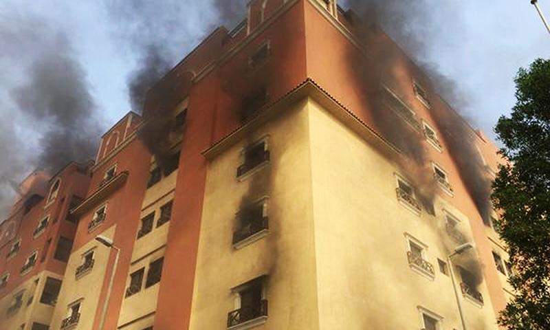 In this image released by the Saudi Interior Ministry's General Directorate of Civil Defense, smoke billows from a fire at a residential complex used by state oil giant Saudi Aramco in Khobar, Saudi Arabia, Sunday, Aug. 30, 2015. — AP