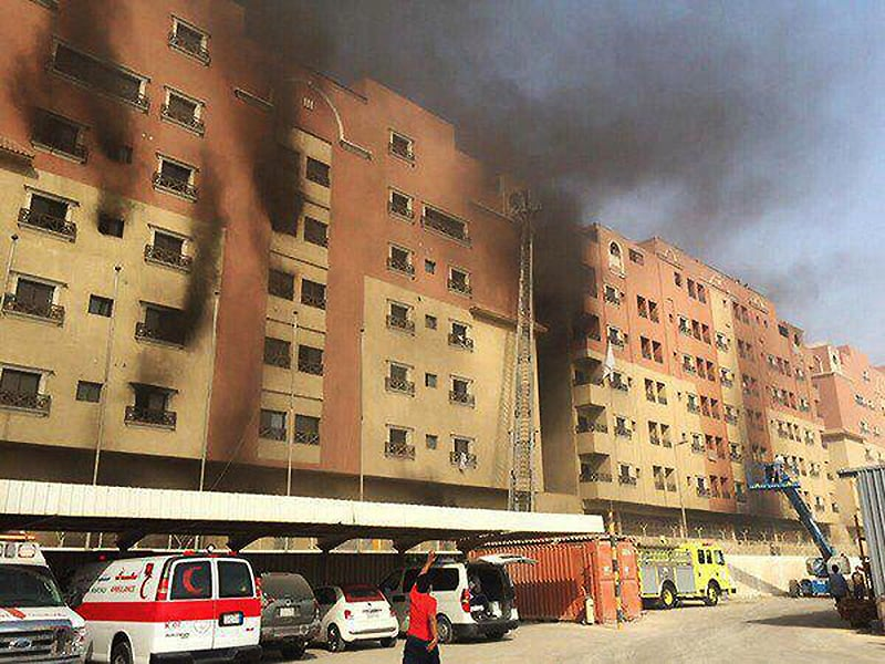 In this image released by the Saudi Interior Ministry's General Directorate of Civil Defense, smoke billows from a residential complex in Khobar, Saudi Arabia, Sunday, Aug. 30, 2015.  — AP
