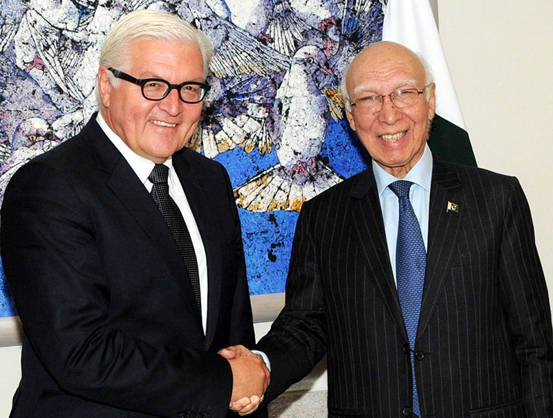 Adviser to the Prime Minister on National Security and Foreign Affairs, Sartaj Aziz during a handshake with with the Foreign Minister of Germany, HE Dr. Farank-Walter Steinmeier in Islamabad on August 31, 2015. — PID
