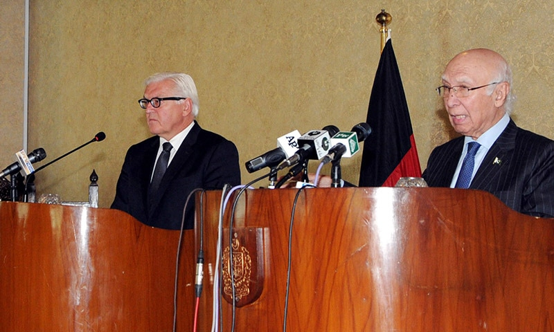Sartaj Aziz and Foreign Minister of Germany Dr. Steinmeier during the press conference at Foreign Office. — PID