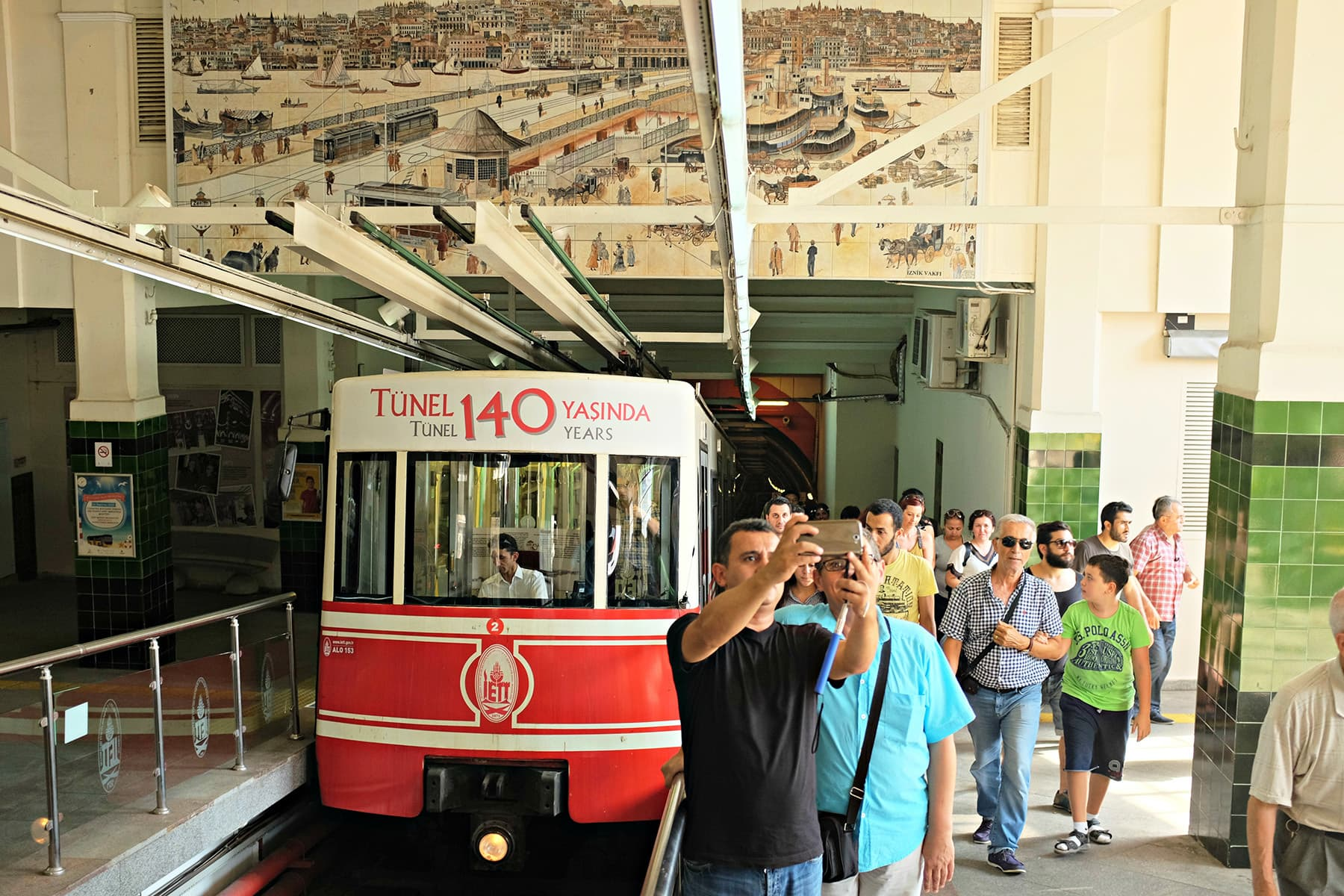 People pose for a selfie in front of tram which took us through the tunnel.