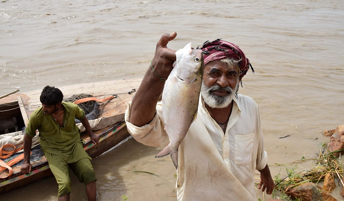 A fisherman shows his catch. -Photo by author