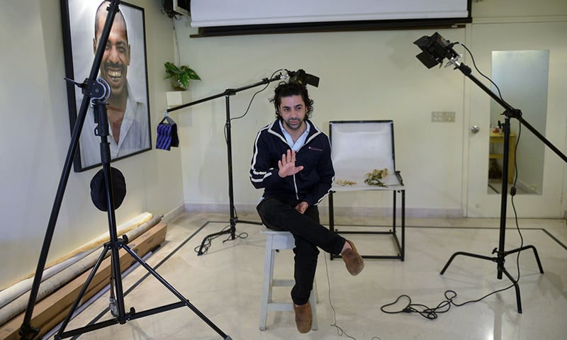 Izdeyar Setna, a member of Karachi's Parsi community, speaks to AFP during an interview at his studio in Karachi. — AFP