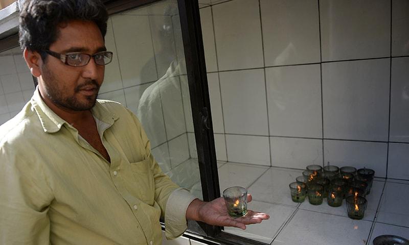 A man standing inside a fire temple in Karachi. — AFP