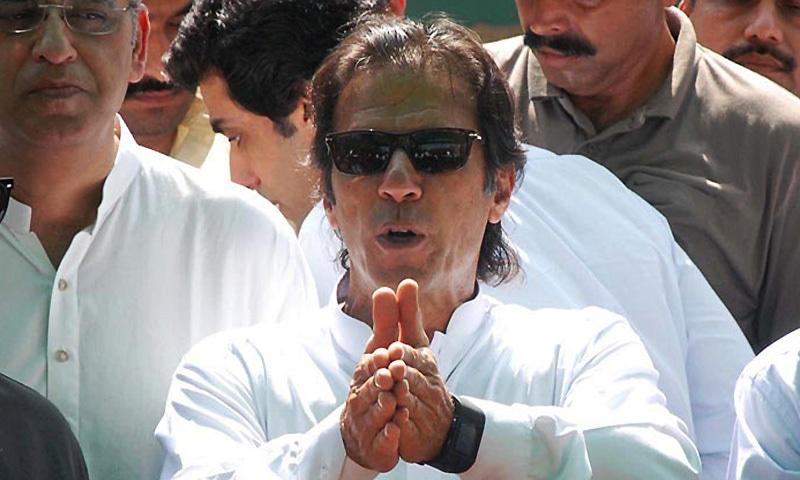 Chairman Pakistan Tahreek-i-Insaf Imran Khan talking to the media persons. — Online