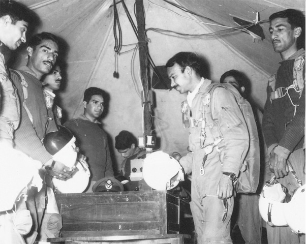 A scene inside a field air ops room during the Indo-Pak War 1965. Squadron Leader M M Alam is seen in the centre. — Dawn File Photo
