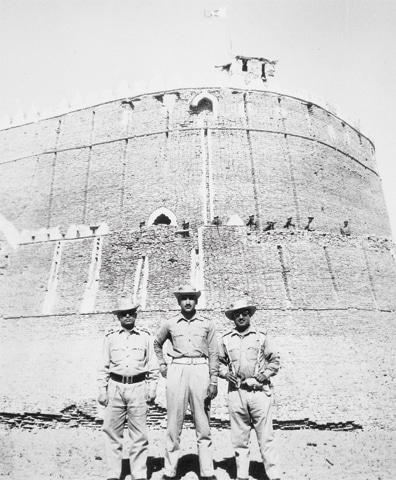 Three Pakistani officers pose for a picture in front of the imposing structure of the ancient Rajasthan Fort at Gotaro. This was one of the chain of forts and other fortifications captured by Pakistan's Desert Force during September 1965. — Dawn File Photo
