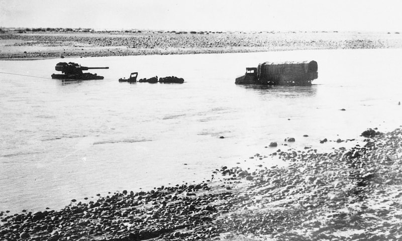 The panic which prevailed amongst the Indian troops while fleeing from Chhamb can be seen from this picture. It shows an Indian Army Truck, a jeep with a trailer and AMX tank abandoned in the middle of the river Ravi. The gun of the tank is facing to Pakistan side ready to fight. But the tank crew along with other occupants of the truck and the jeep would rather choose to run for their life than fire their guns. — Dawn File Photo