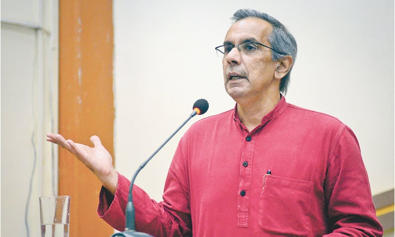 political economist Dr S. Akbar Zaidi making a point during his lecture 'Questioning Pakistan's history' organised by the Faculty of Social Sciences, Karachi University, on Friday.—White Star