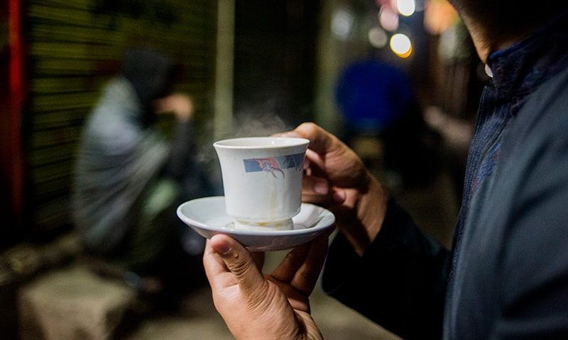 A man enjoys some roadside tea