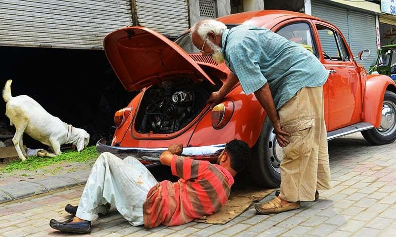 Don't forget to take your trusty mechanic when you go to check out the car! — AFP