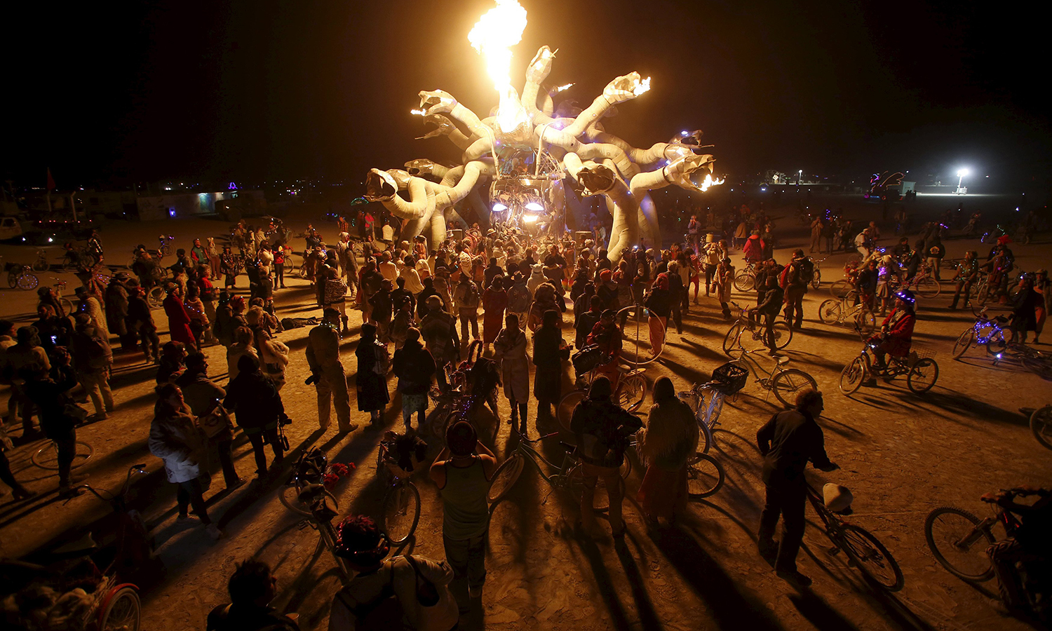 """Participants gather at Medusa Madness during the Burning Man 2015 """"Carnival of Mirrors"""" arts and music festival in the Black Rock Desert of Nevada on September 6, 2015. — Reuters"""