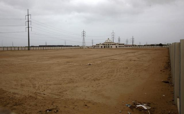 A view of the unfinished field at the Goal Project site, Hawkes Bay, Karachi, July 2015. — Reuters