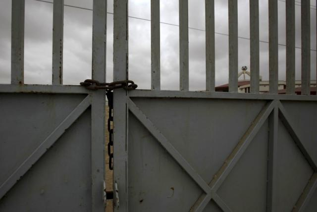 The chained entrance to the FIFA Goal Project site at Hawkes Bay, Karachi, July 2015. — Reuters
