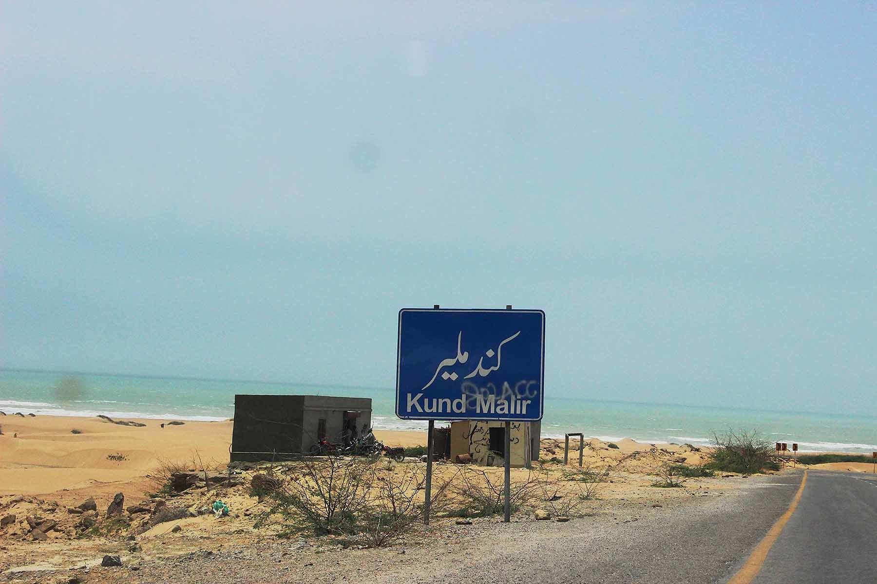 Signboard displaying the start of Kund Malir Beach.
